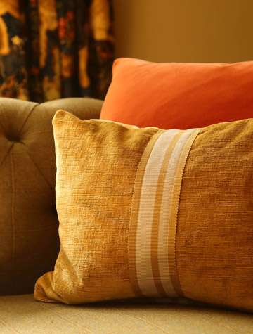 Antler orange cushion