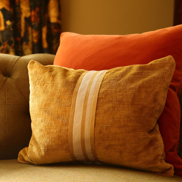 Antler orange cushions